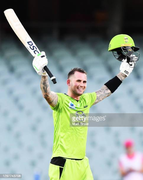 Alex Hales of the Thunder celebrates bringing up his century during the Big Bash League match between the Sydney Sixers and the Sydney Thunder at...