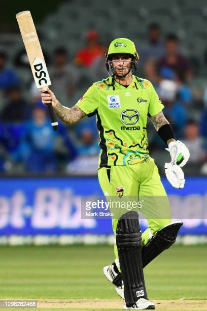 Alex Hales of the Thunder celebrates making his half century during the Big Bash League match between the Adelaide Strikers and the Sydney Thunder at...