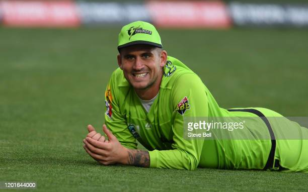 Alex Hales of the Thunder reacts after failing to stop a boundary during the Big Bash League match between the Hobart Hurricanes and the Sydney...
