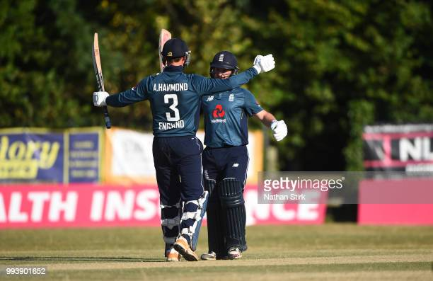 Alex Hammond hugs Callum Flynn of England after they beat Bangladesh during the Vitality IT20 Physical Disability TriSeries match between England and...