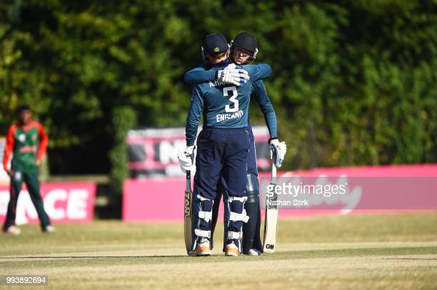 Alex Hammond is hugged by Hugo Hammond of England after he scores 50 runs during the Vitality IT20 Physical Disability TriSeries match between...