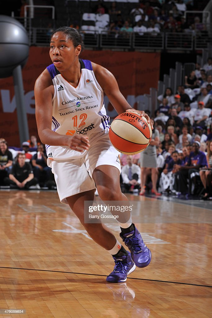 0b97792415fb Alex Harden of the Phoenix Mercury drives to the basket against the ...
