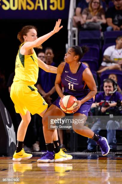 345854077f27 Alex Harden of the Phoenix Mercury drives to the basket against the Seattle  Storm during a