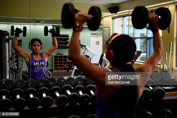 Alex Harrington does shoulder presses while lifting weights in the weight room at Brighton Recreation Center in Brighton Colorado on October 13 2016...