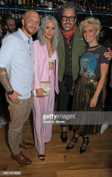 Alex Harrison Victoria Magrath Larry King and Laura King attend the Emporio Armani Fragrance 'Stronger With You' party at Roast on July 18 2018 in...