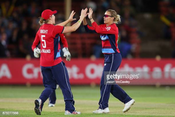 Alex Hartley and Heather Knight of England celebrate the wicket of Ashleigh Gardner of Australia during the first Women's Twenty20 match between...