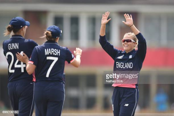 Alex Hartley high fives Laura Marsh of England Women's during the ICC women's world cup warm up match between England Women's and New Zealand on June...