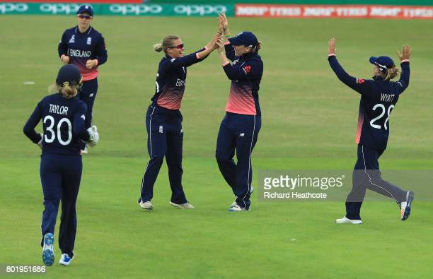 Alex Hartley of England celebrates taking the wicket of Asmavia Iqbal of Pakistan during the Women's ICC World Cup group match between England and...