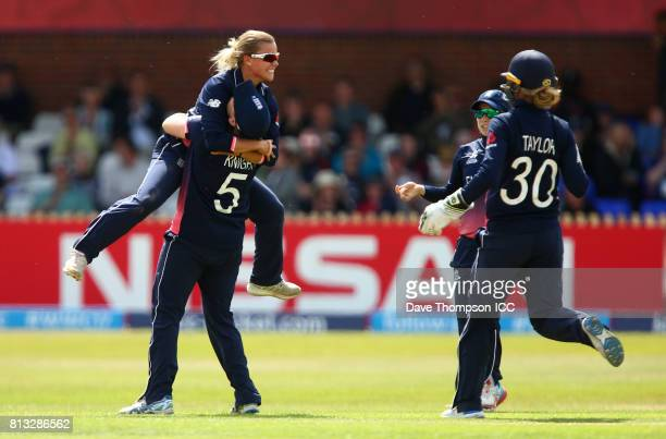 Alex Hartley of England celebrates with Heather Knight of England after taking the wicket of Suzie Bates of New Zealand during the ICC Women's World...