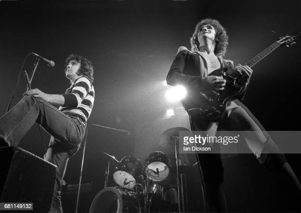 Alex Harvey and Zal Cleminson of The Sensational Alex Harvey Band performing on stage at New Victoria Theatre London 23 December 1975