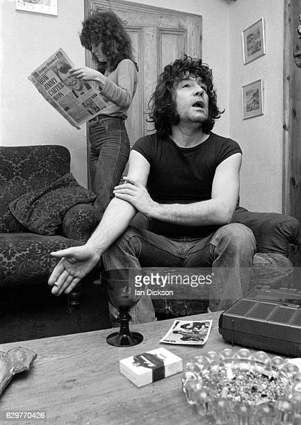 Alex Harvey is interviewed at home with his wife Trudi standing in the background 1976