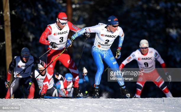Alex Harvey of Canada and Matti Heikkinen of Finland compete in the Men's Cross Country Skiathlon during the FIS Nordic World Ski Championships on...