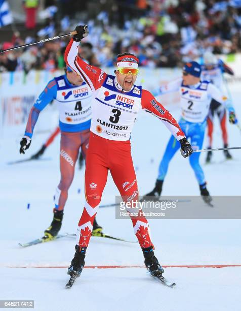 Alex Harvey of Canada celebrates winning the gold medal in the Men's Cross Country Mass Start during the FIS Nordic World Ski Championships on March...