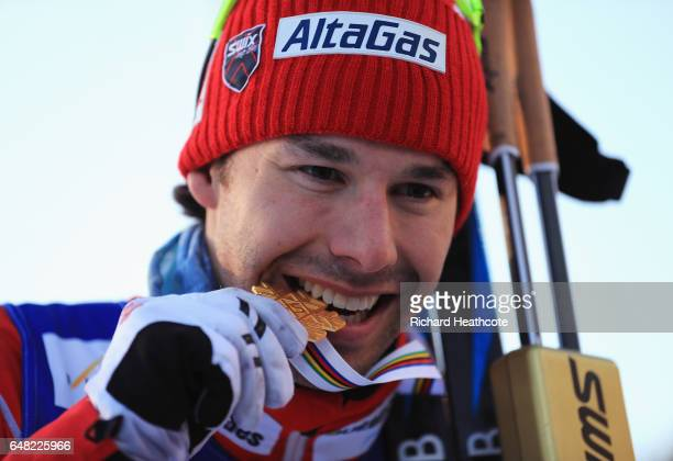 Alex Harvey of Canada celebrates winning the gold medal in the Men's Cross Country Mass Start during the flower ceromeny during the FIS Nordic World...