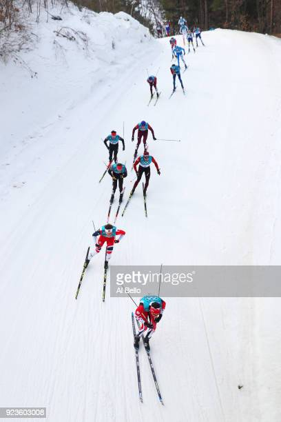 Alex Harvey of Canada Emil Iversen of Norway Andreas Katz of Germany and Dario Cologna of Switzerland compete during the Men's 50km Mass Start...