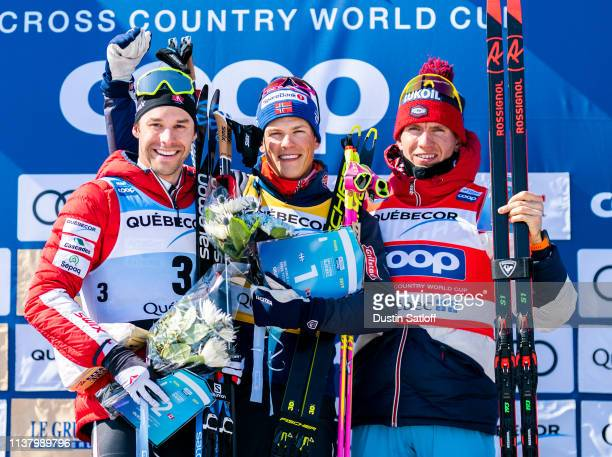 Alex Harvey of Canada, Johannes Hoesflot Klaebo of Norway, and Alexander Bolshunov of Russia on the podium after the Men's 15km freestyle pursuit...