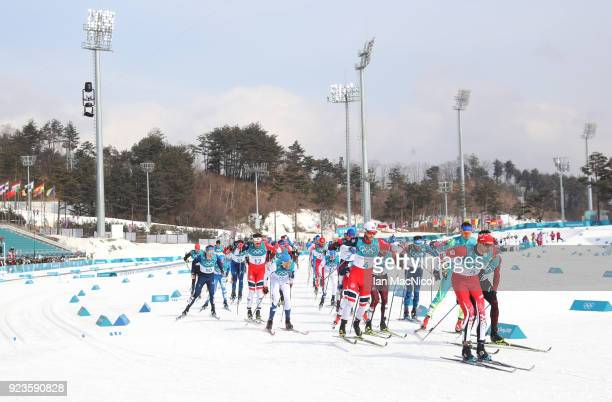Alex Harvey of Canada leads out the Men's 50km Mass Start Classic at Alpensia CrossCountry Centre on February 24 2018 in Pyeongchanggun South Korea