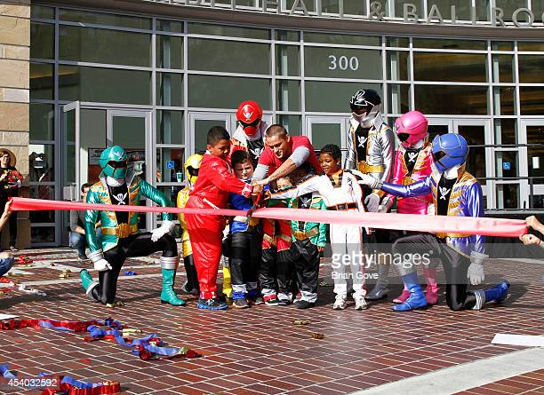 Alex Heartman and Power Rangers attend MakeAWish RibbonCutting Ceremony For POWER UP Power MorphiconPasadena Convention Center on August 23 2014 in...