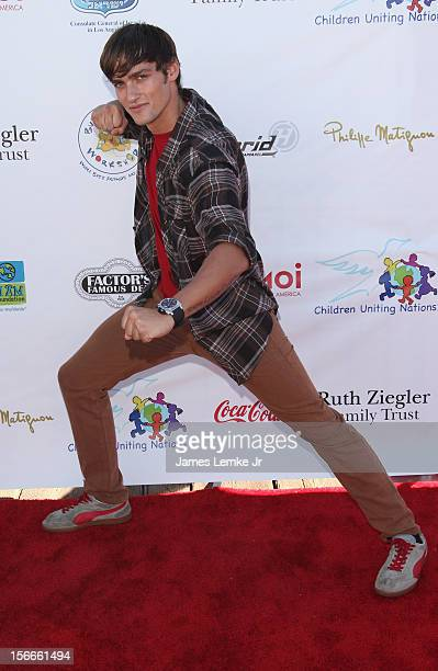 Alex Heartman attends the Children Uniting Nations' Day of The Child Fundraiser held at the Santa Monica Pier on November 18 2012 in Santa Monica...