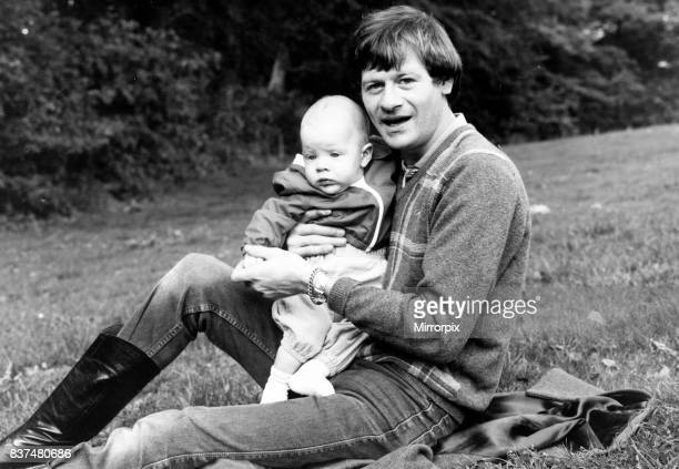 Alex Higgins former World Snooker Champion 1983 with his son at home.