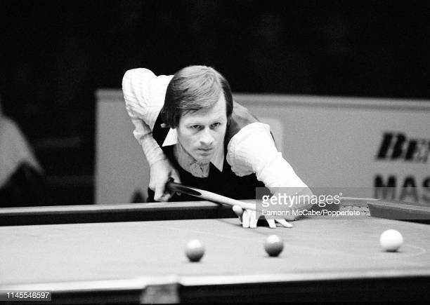 Alex Higgins in action during the Benson Hedges Masters Final against Cliff Thorburn at the Wembley Conference Centre on January 31 1981 in London...
