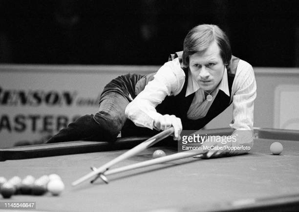 Alex Higgins in action during the Benson & Hedges Masters Final against Cliff Thorburn at the Wembley Conference Centre on January 31, 1981 in...