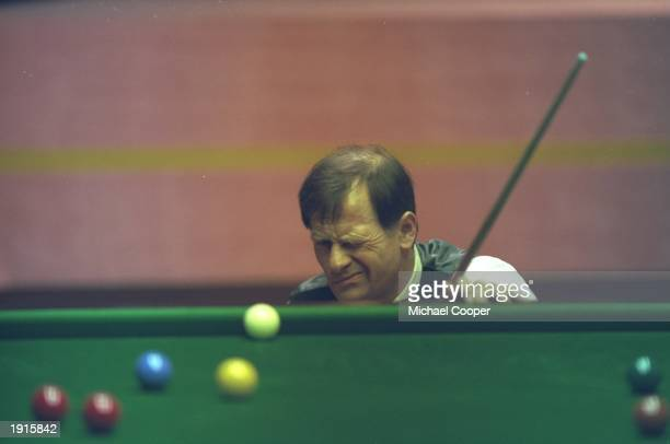 Alex Higgins of Ireland lines up a shot during the 1994 Embassy World Snooker Championships at the Crucible Theatre in Sheffield England Mandatory...