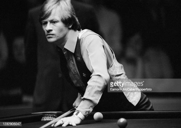 Alex Higgins of Northern Ireland in action against Steve Davis of England in the semi final of the Embassy World Snooker Championship at the Crucible...