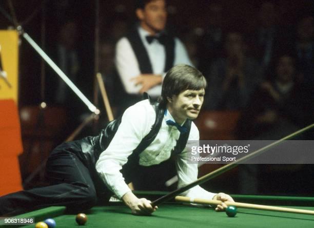 Alex Higgins of Northern Ireland in action, circa 1990.