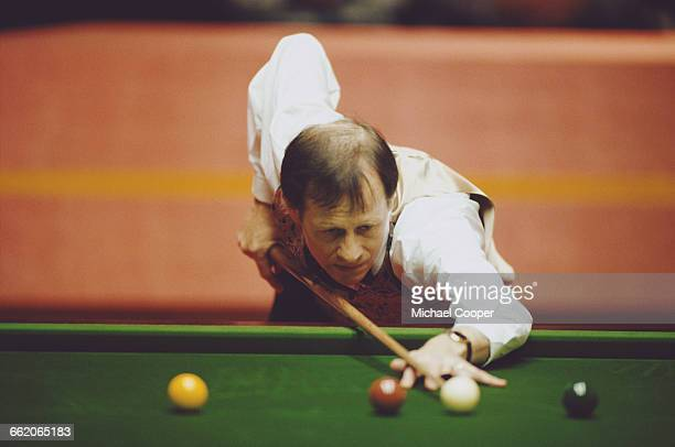 Alex Higgins of Northern Ireland lines up the cue ball during his World Snooker Championship first round match against Ken Doherty on 16 April 1994...