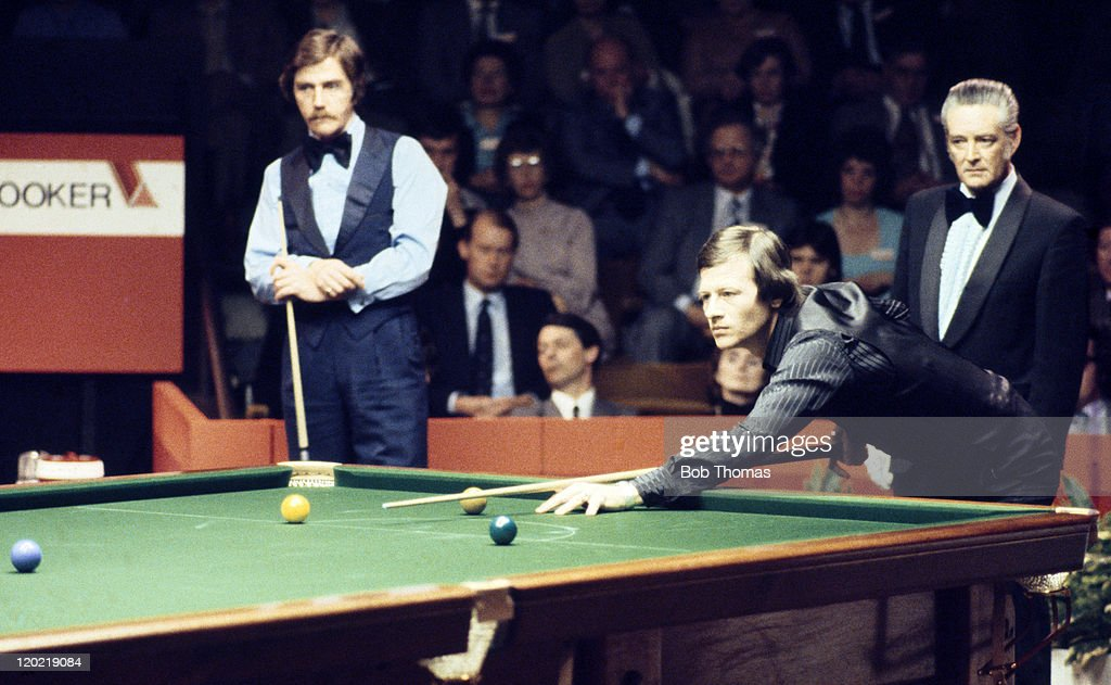 Alex Higgins of Northern Ireland (second right) playing Ciff Thorburn of Canada (left) in the World Snooker Championship Final at the Crucible in Sheffield, circa May 1980. Thorburn won 18-16.