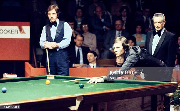 Alex Higgins of Northern Ireland playing Ciff Thorburn of Canada in the World Snooker Championship Final at the Crucible in Sheffield circa May 1980...