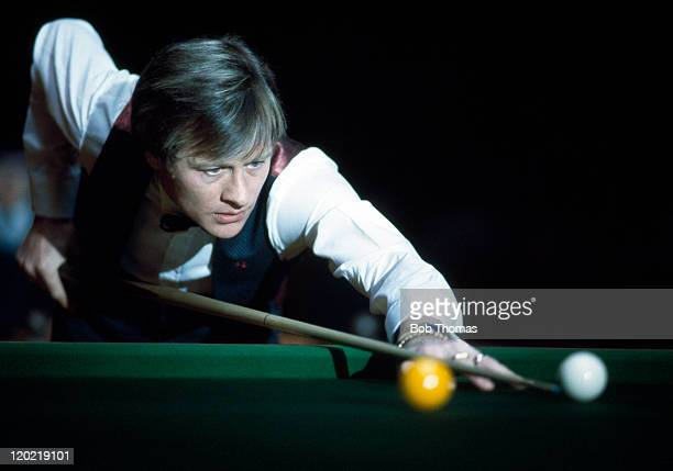 Alex Higgins of Northern Ireland playing in the Snooker Masters Championship at Wembley Arena in London circa January 1984
