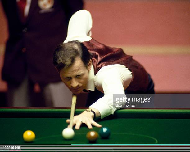 Alex Higgins of Northern Ireland playing in the World Snooker Championship at the Crucible in Sheffield circa April 1988