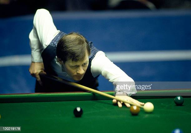 Alex Higgins of Northern Ireland playing in the World Snooker Championship at the Crucible in Sheffield circa April 1987