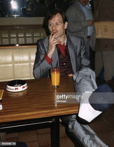 Alex Higgins snooker player alias Hurricane Higgins smoking cigar and drinking orange juice at a Deauville bar