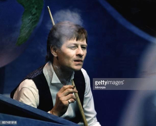 Alex Higgins snooker player alias Hurricane Higgins smoking cigarette during a match 1988.