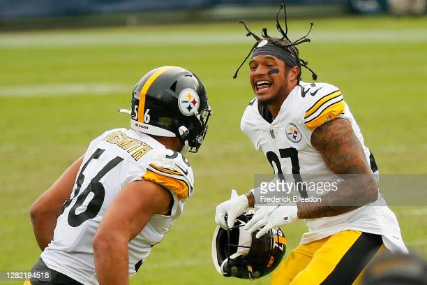 Alex Highsmith of the Pittsburgh Steelers and teammate Marcus Allen celebrate after the Titans miss a game-tying field goal attempt in the final...