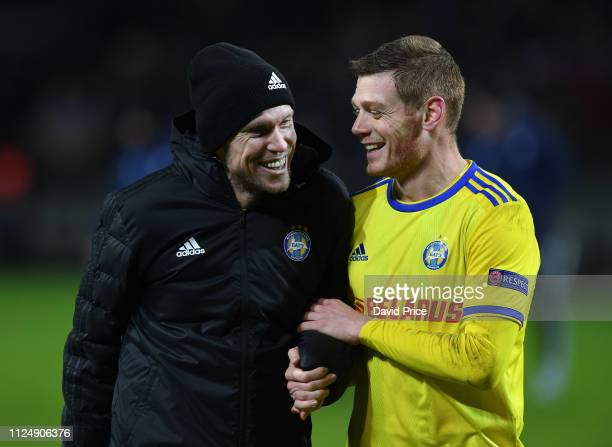 Alex Hleb and Aleksandar Filipovic of BATE after the UEFA Europa League Round of 32 First Leg match between BATE Borisov and Arsenal on February 14...