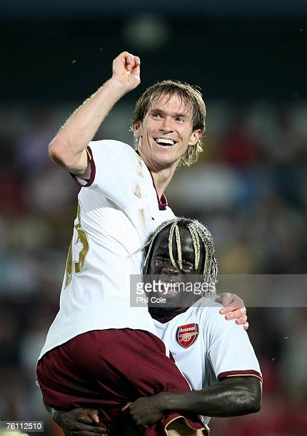 Alex Hleb of Arsenal gets congratulated by Bacary Sagna after scoring during the Champions League 3rd qualifying round 1st leg between Sparta Prague...