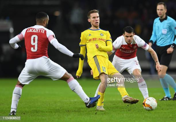 Alex Hleb of Arsenal is closed down by Granit Xhaka and Alexandre Lacazette of Arsenal during the UEFA Europa League Round of 32 First Leg match...