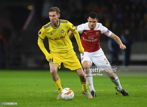Alex Hleb of Arsenal is closed down by Granit Xhaka of Arsenal during the UEFA Europa League Round of 32 First Leg match between BATE Borisov and...