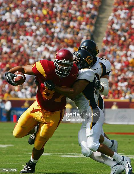 Alex Holmes of the USC Trojans runs the ball during the game against the California Golden Bears on October 9 2004 at Los Angeles Memorial Coliseum...
