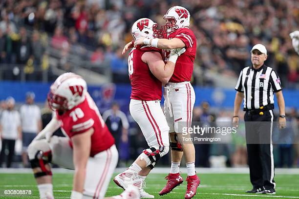 Alex Hornibrook and Zack Baun of the Wisconsin Badgers celebrate after a touchdown in the fourth quarter during the 81st Goodyear Cotton Bowl Classic...