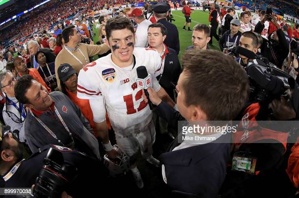 Alex Hornibrook of the Wisconsin Badgers celebrates after winning the 2017 Capital One Orange Bowl against the Miami Hurricanes against the Miami...