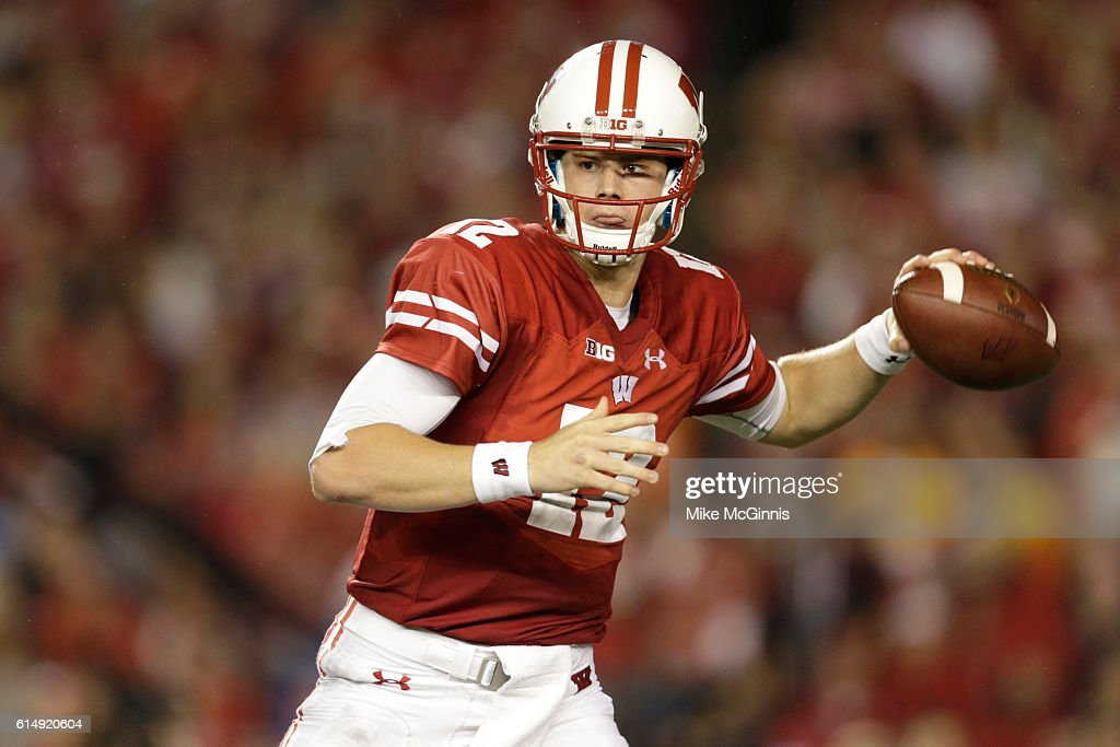 Alex Hornibrook #12 of the Wisconsin Badgers drops back and passes the football during the second quarter against the Ohio State Buckeyes at Camp Randall Stadium on October 15, 2016 in Madison, Wisconsin.