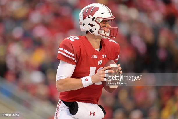 Alex Hornibrook of the Wisconsin Badgers drops back to pass during the second quarter of a game against the Michigan Wolverines at Camp Randall...