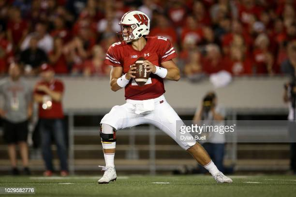 Alex Hornibrook of the Wisconsin Badgers drops back to pass in the first quarter against the Western Kentucky Hilltoppers at Camp Randall Stadium on...