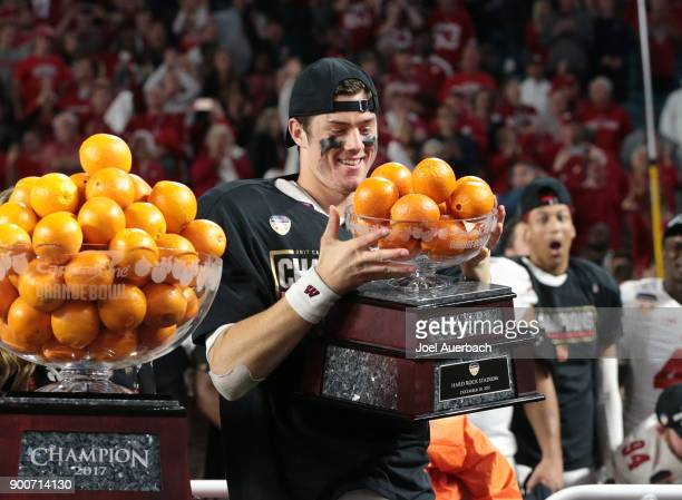 Alex Hornibrook of the Wisconsin Badgers is awarded the MVP trophy after the win against the Miami Hurricanes during the 2017 Capital One Orange Bowl...