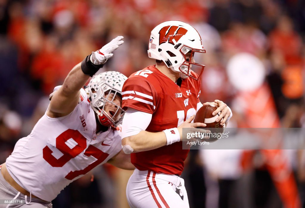 Alex Hornibrook #12 of the Wisconsin Badgers is sacked by Nick Bosa #97 of the Ohio State Buckeyes in the Big Ten Championship at Lucas Oil Stadium on December 2, 2017 in Indianapolis, Indiana.